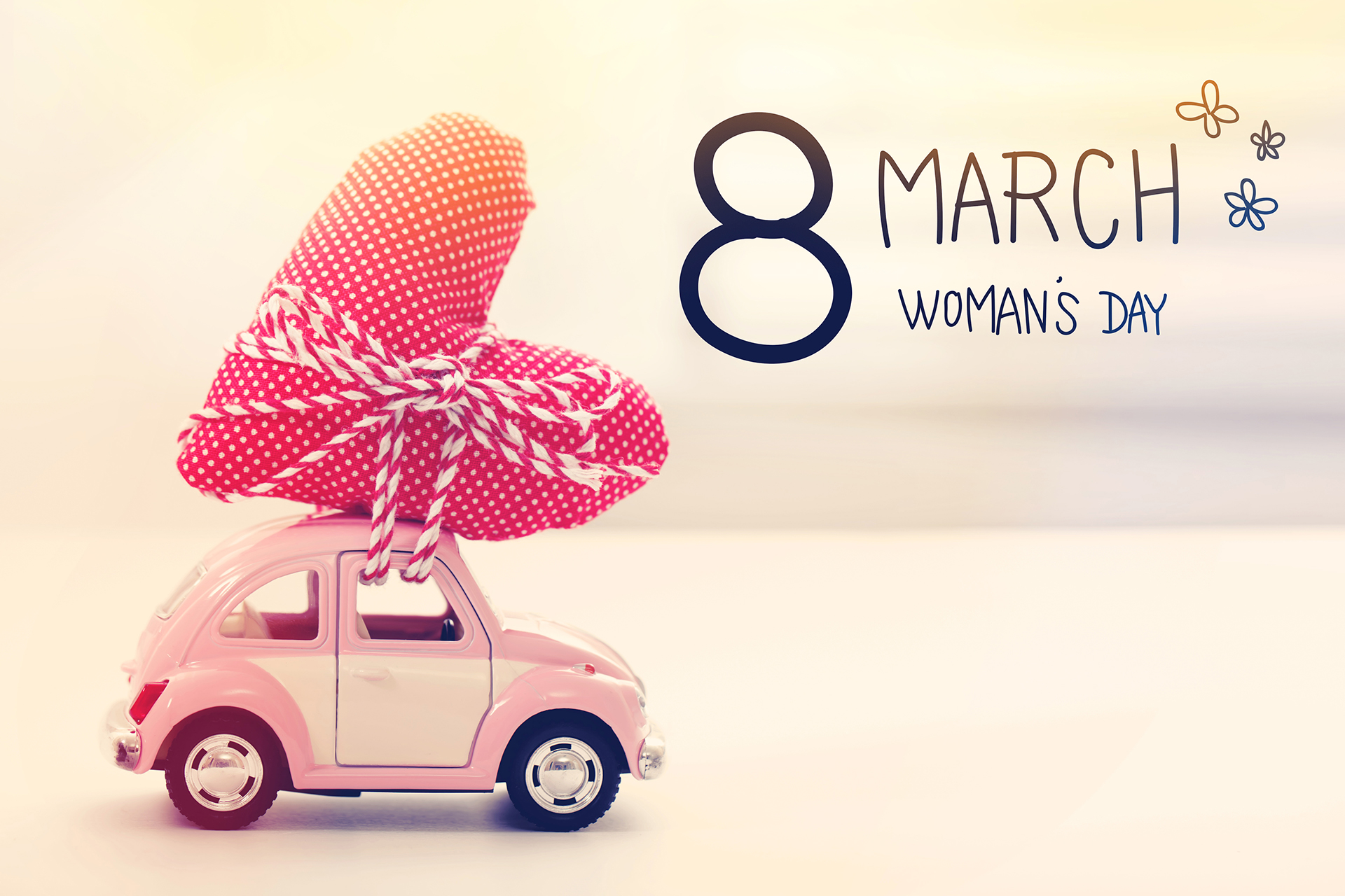 Womans Day message with miniature pink